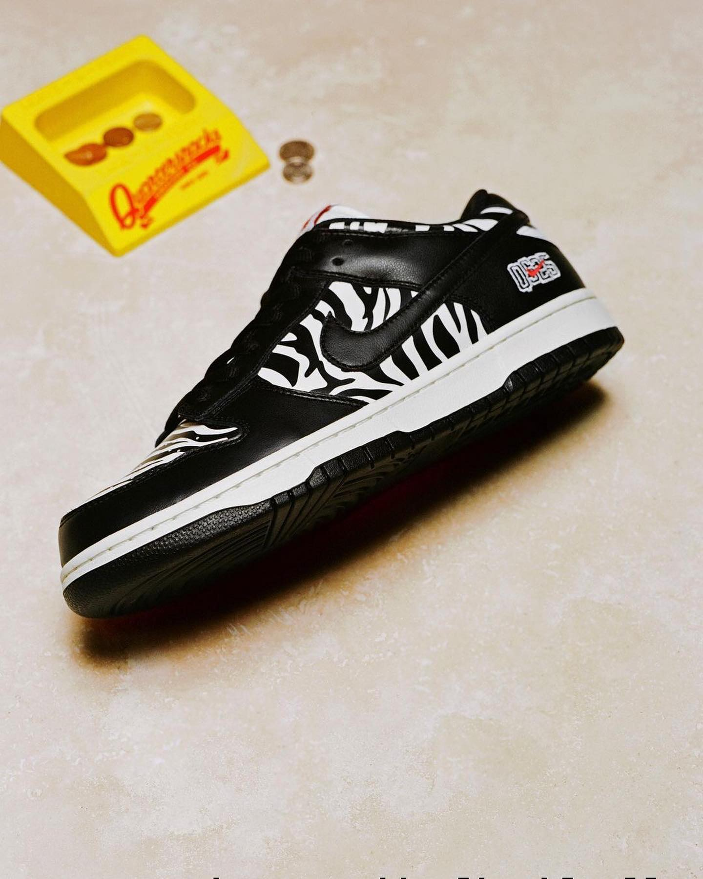 🗣 @nikesb Mixing black leather overlays and zebra-striped paneling that extends from toe box to heel, the @quartersnacks Dunk Low takes inspiration from on-the-cheap candy counter nostalgia. Learn more at NikeSB.com.