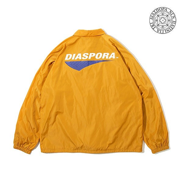 @diaspora_skateboards DIASPORA / TOUR LOGO COACH JACKETオリジナルボディを使用したコーチジャケット。自然な発色のシワになりにくい素材を使用。しっとりした高級感のあるボディ。フロントとバックにTour Logoをプリント。